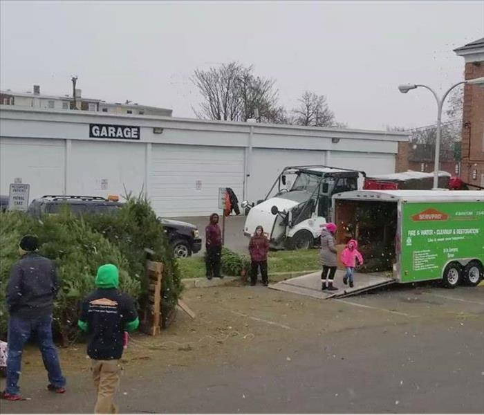 Christmas Trees, Smiles, Children, and SERVPRO