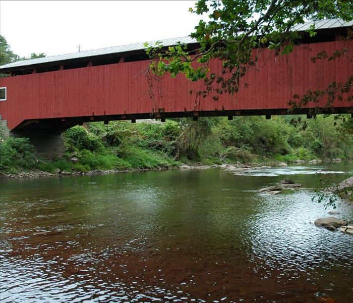 Red Covered Bridge Spanning a Small River